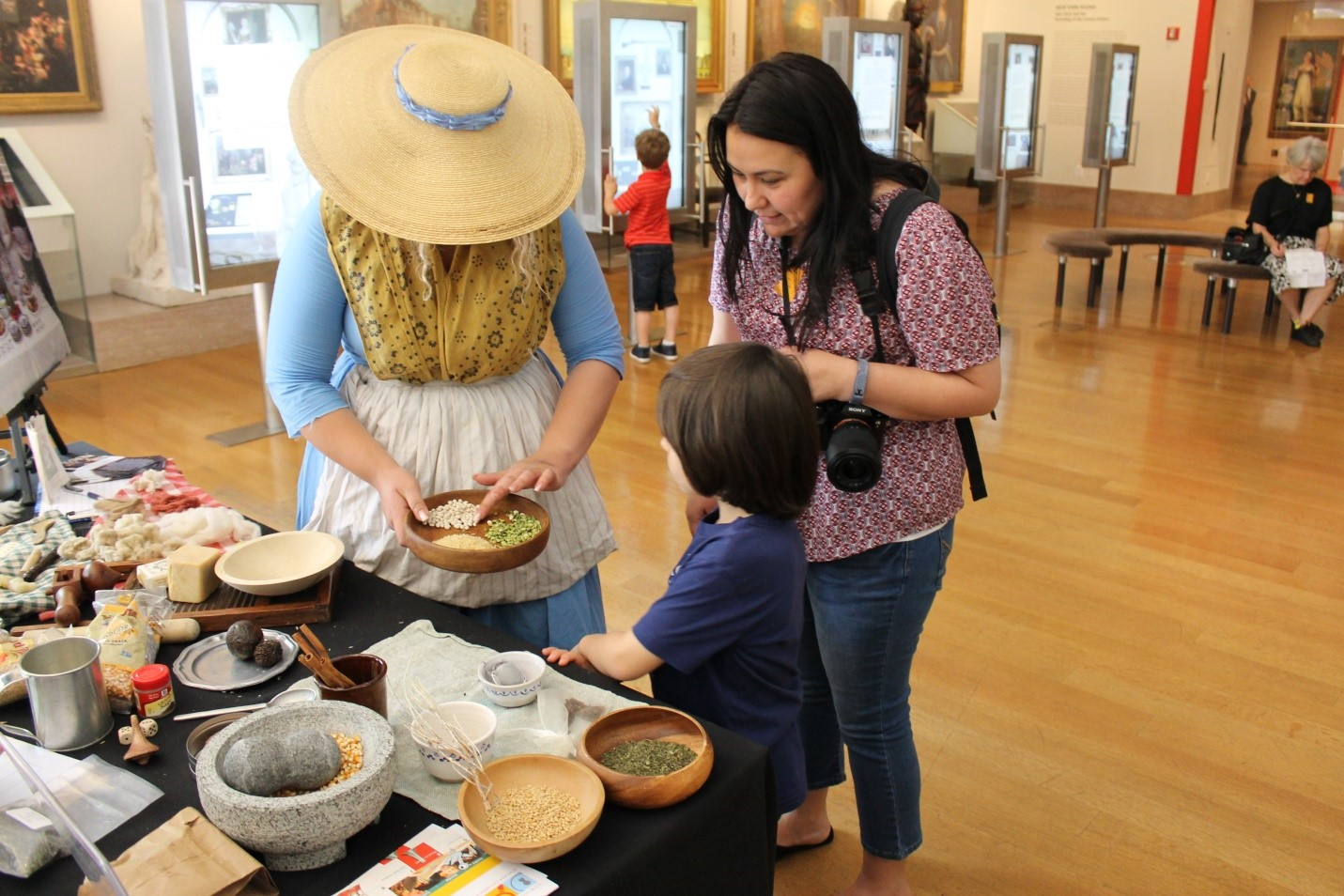 Under the shade of her hat, Dakota prepared 18th century cooking ingredients over Memorial Day Weekend.