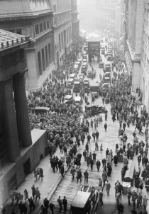 A view from a high up window shows crowds of people gather on Wall Street outside the New York Stock Exchange, directly following the crash.