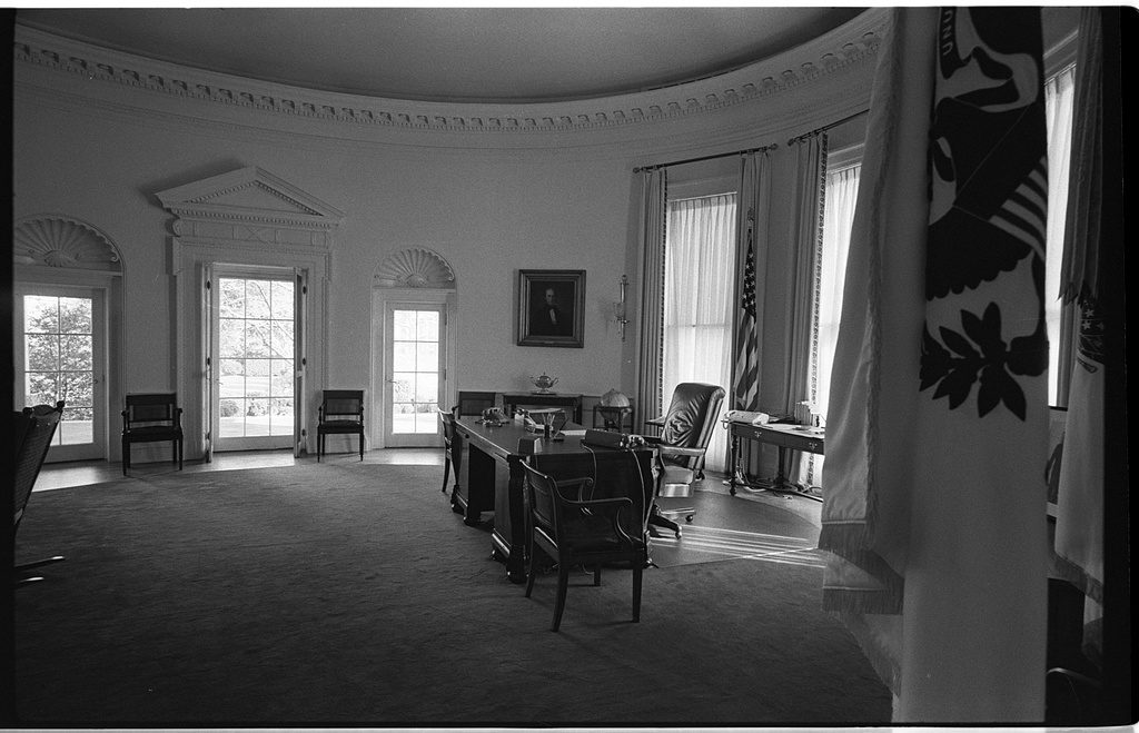 Black and white photo of the Oval Office in the White House, Washington, D.C.