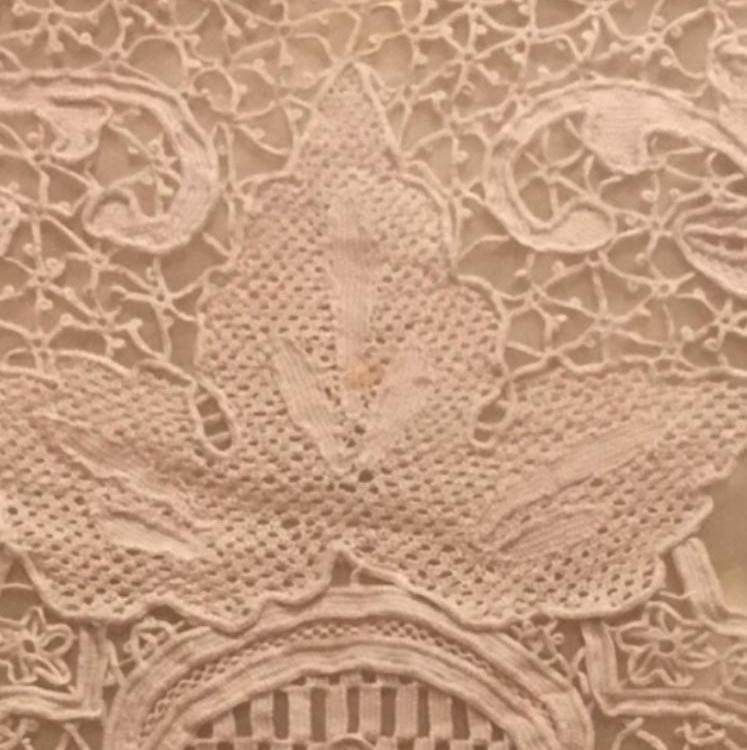 Close-up detail of the lace from a tablecloth, brought to the US from Aleppo, Syria in the 1920's during the immigration of the writer's great-grandfather.